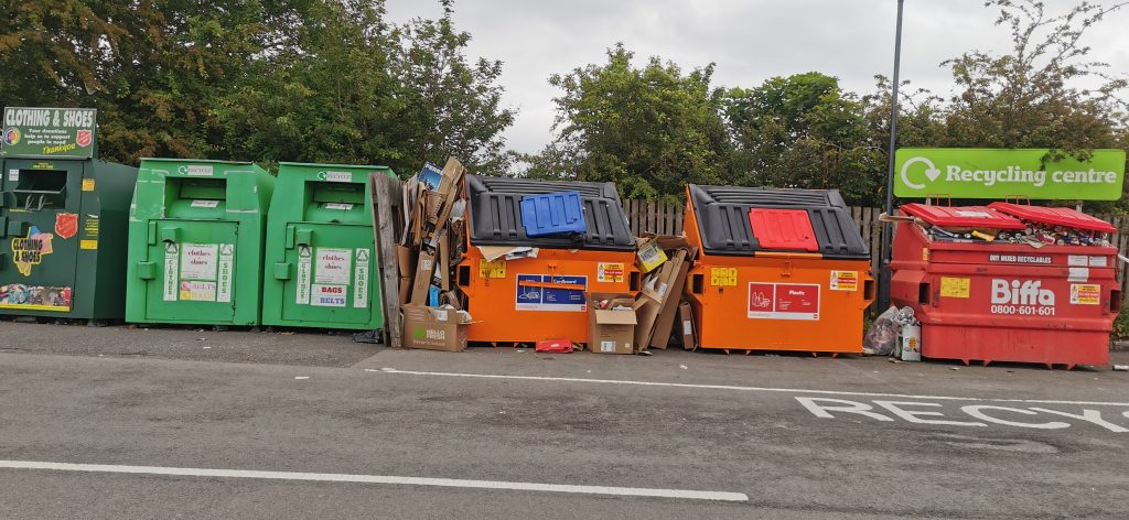 Photo of Recycle bins in car park, Boroughfields Shopping Centre